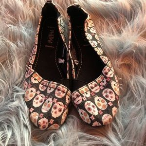 Mad Love sugar skull slip ons